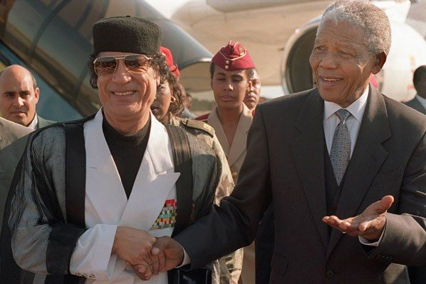 Libya-Leader-Col.-Muammar Gaddafi and South African counterpart Nelson Mandela during the early 1990s